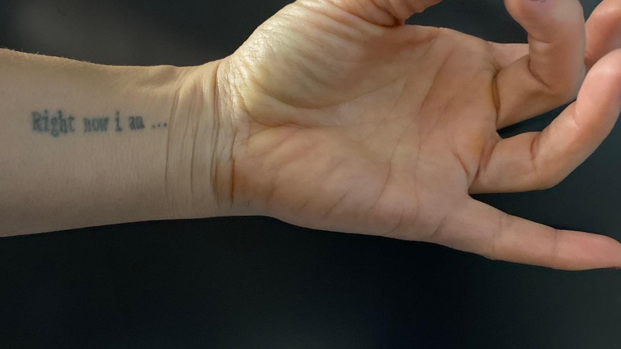 Row now I am...mindfulness tattoo on a wrist. Hand is forming shuni mudra.
