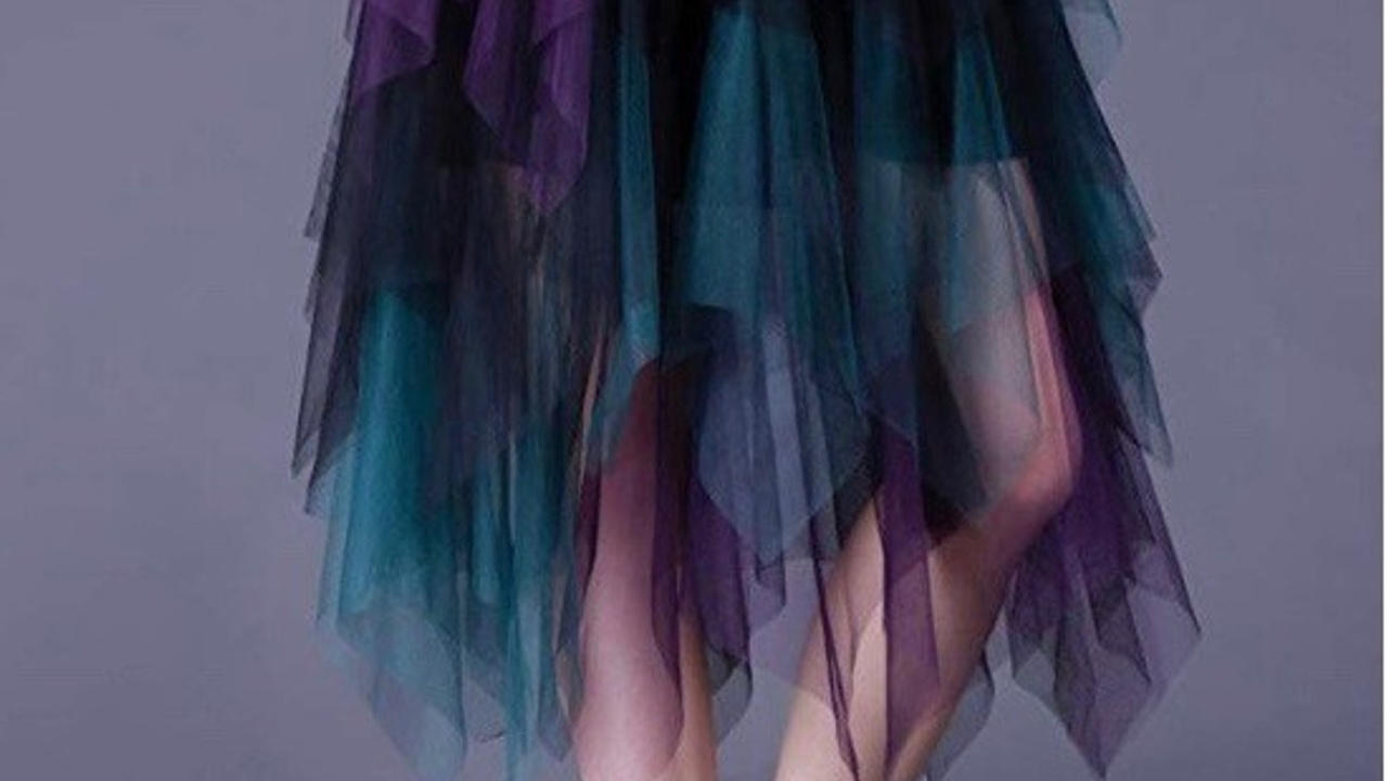 Unique teal, purple, and black tiered tulle skirt for the person who does not care what others think.