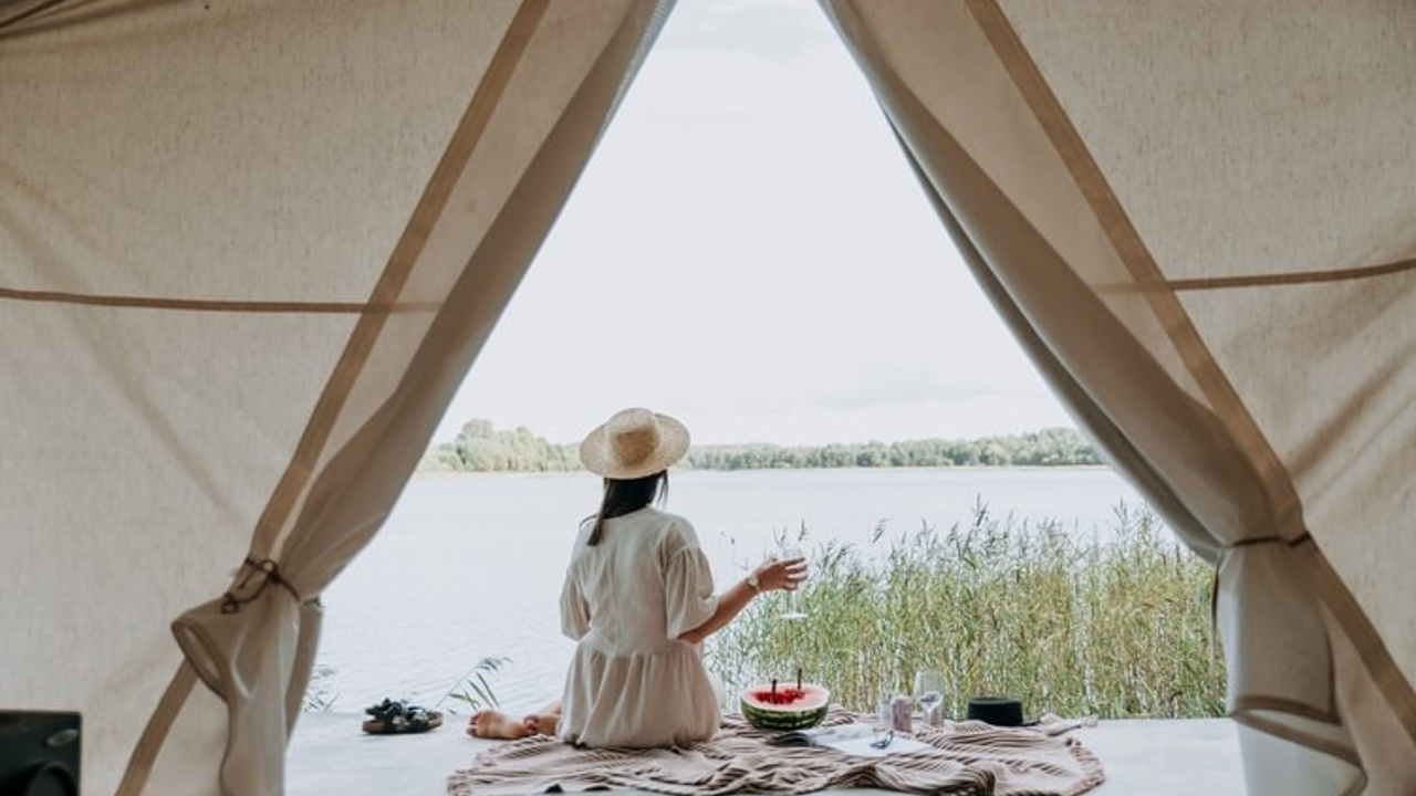 Woman eating outside a tent