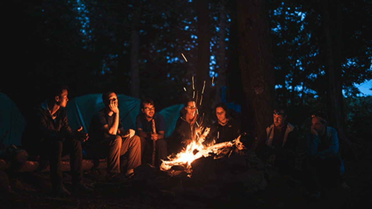 people around a campfire