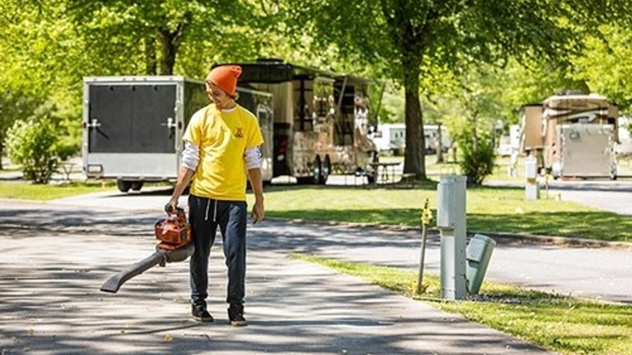 Man blowing leaves