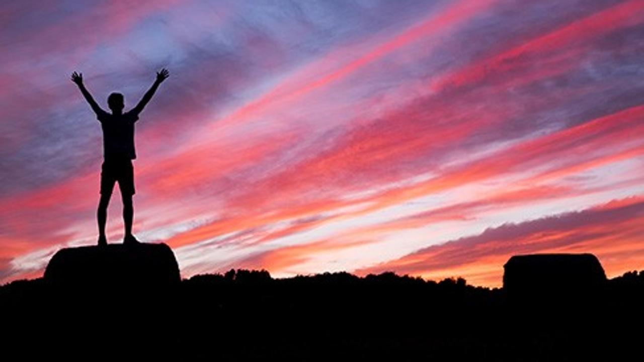 Silhouette overlooking sky