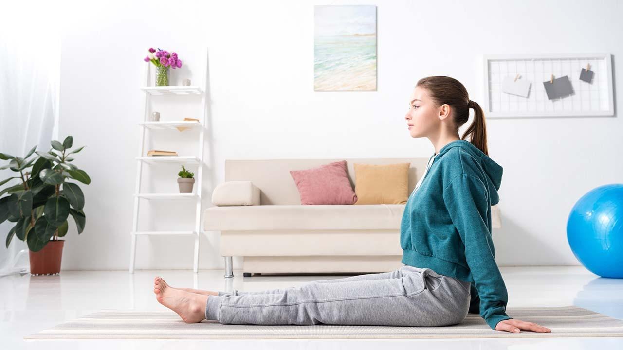 woman stretching hamstrings