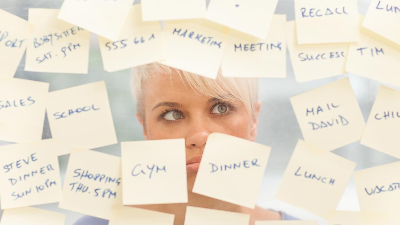 busy woman post it notes