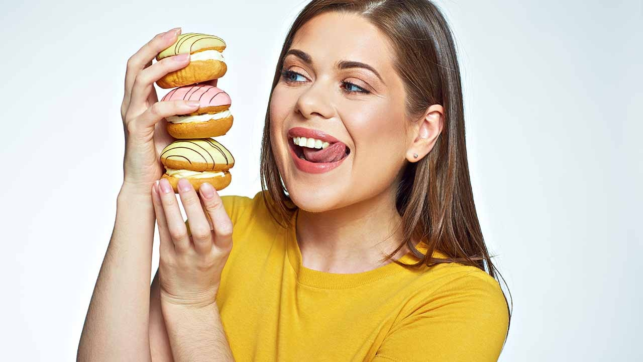 woman with macarons