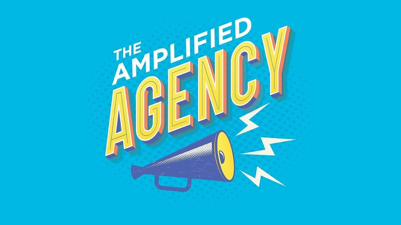 Blue background with text that reads The Amplified Agency with a blue megaphone underneath.