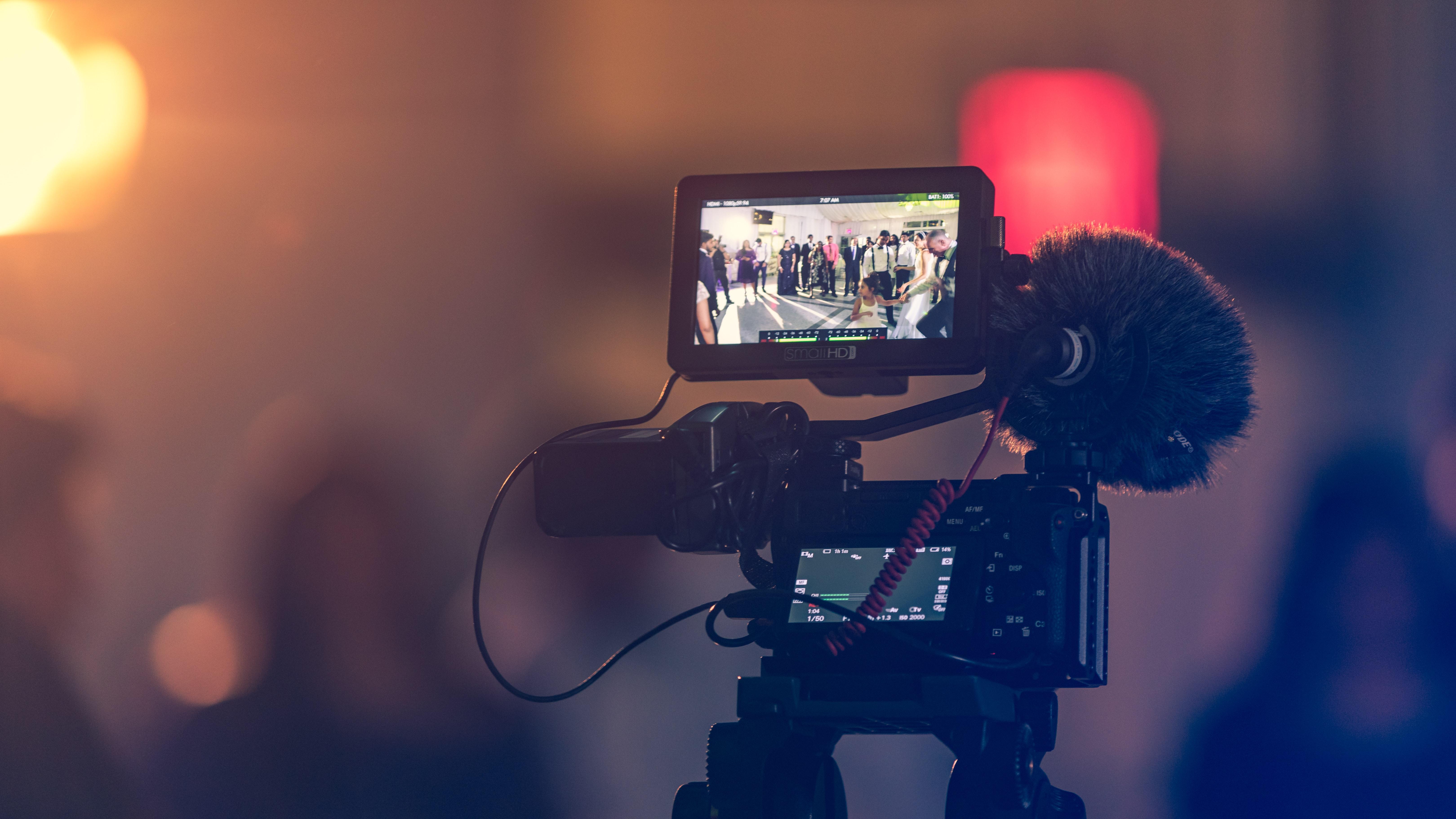 Closeup of film camera filming a scene