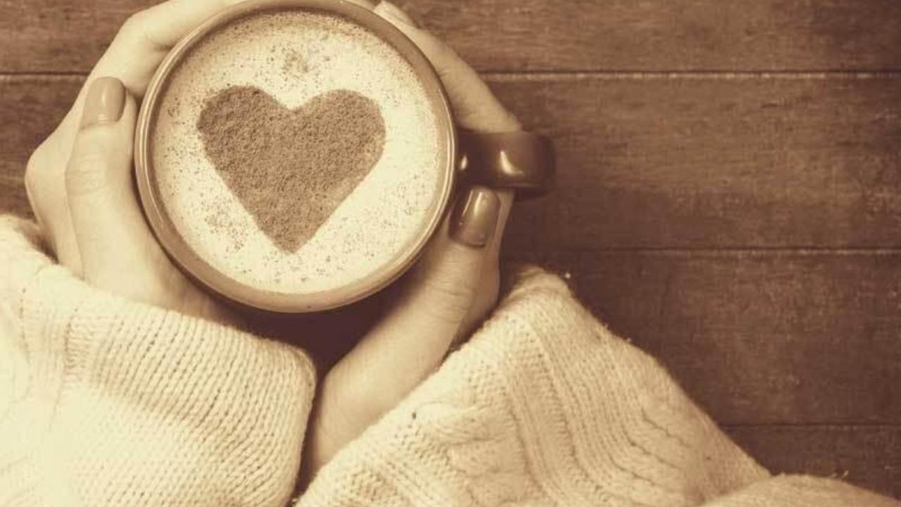 Heart shaped foam in cup of coffee