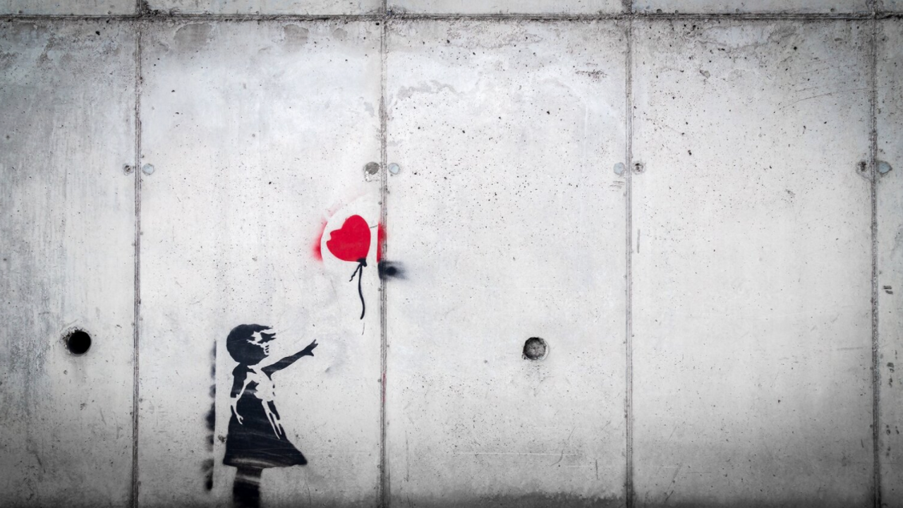 Red balloon painted on wall