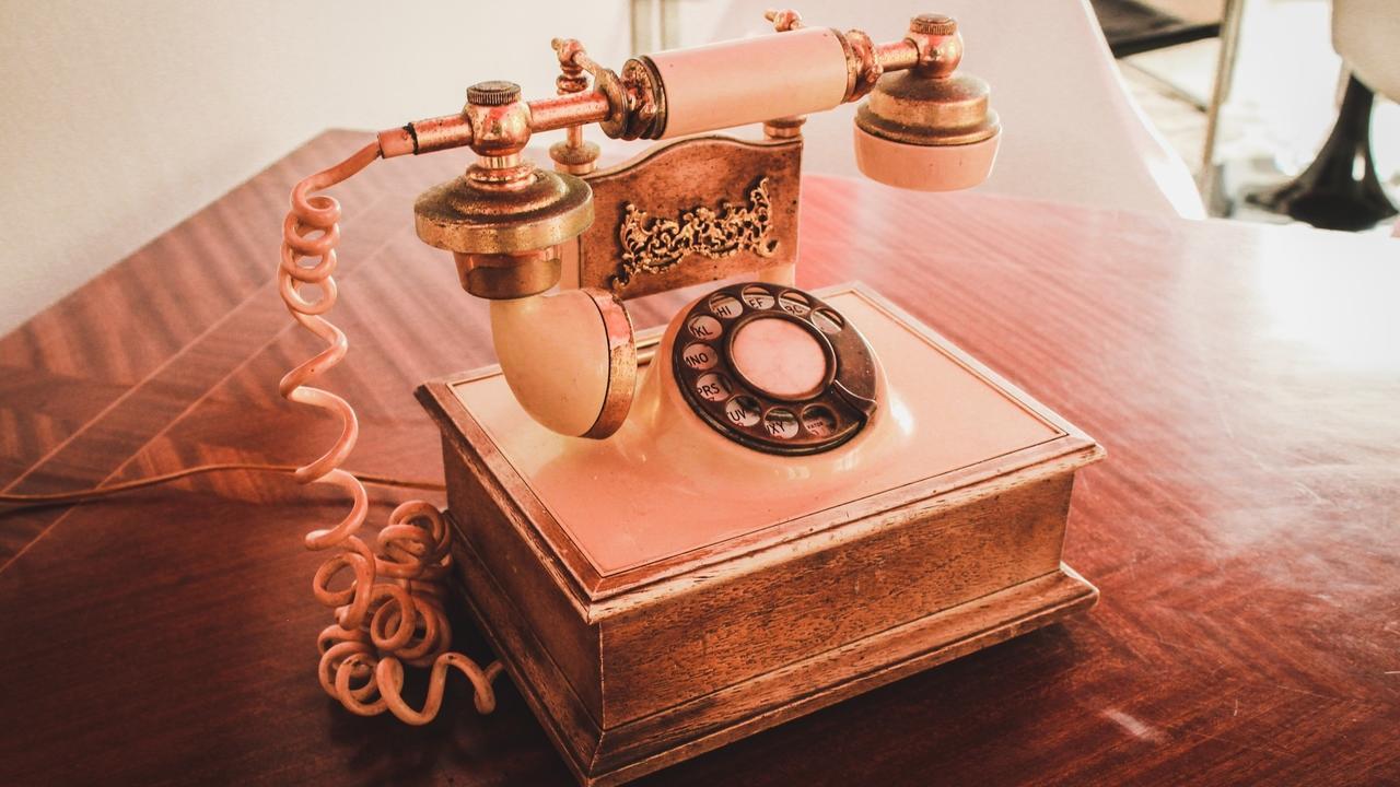 Image of vintage pink telephone.