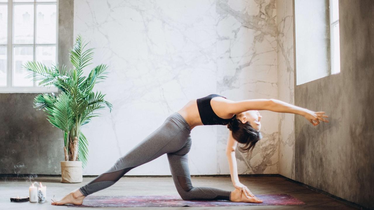 One lady doing Yoga Pozları Stretching one arm and one leg
