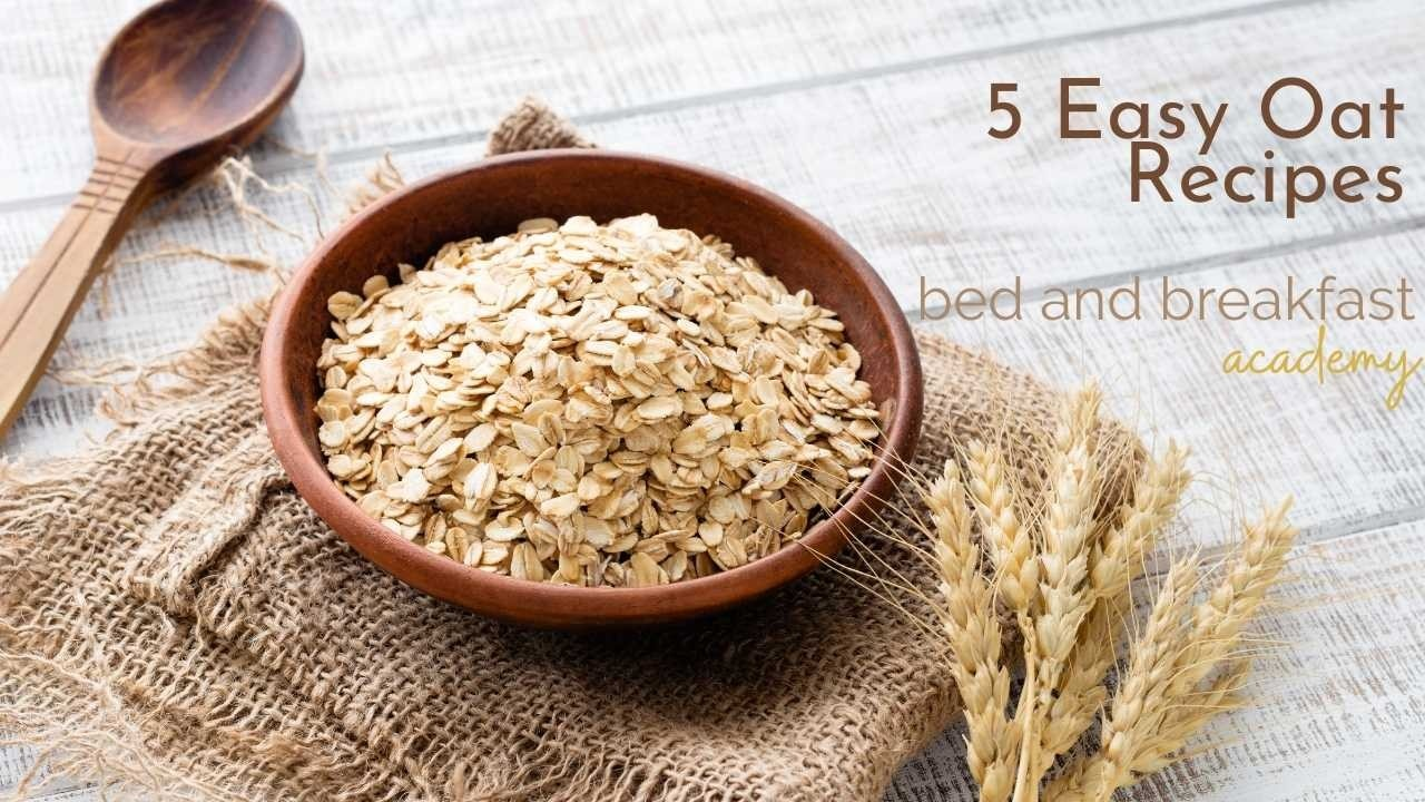 rolled oats in a brown bowl on a hessian sack and a wooden spoon