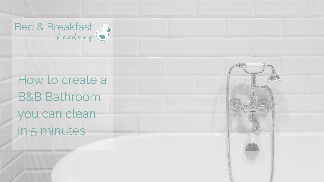 How to create a bathroom you can clean in 5 minutes | white freestanding bath in white tiled bathroom