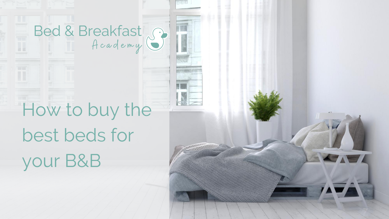 How to buy the best beds for your B&B   low bed in white bedroom with grey quilt