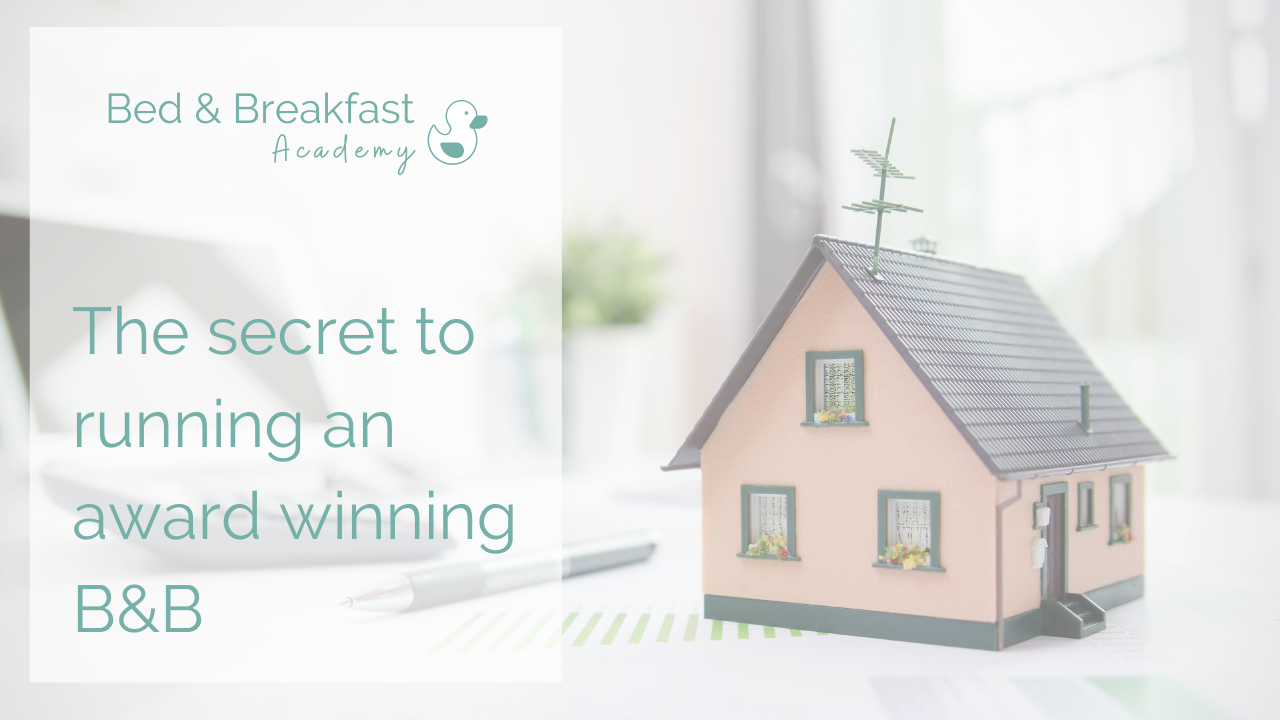 The secret to running an award winning B&B | pink miniature house sitting on a desk