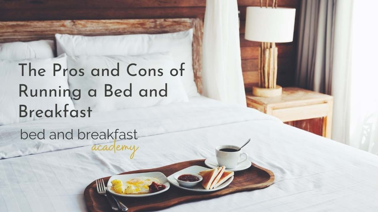 breakfast tray on a white bed with a wooden headboard - text says the pros and cons of running a bed and breakfast - bed and breakfast academy