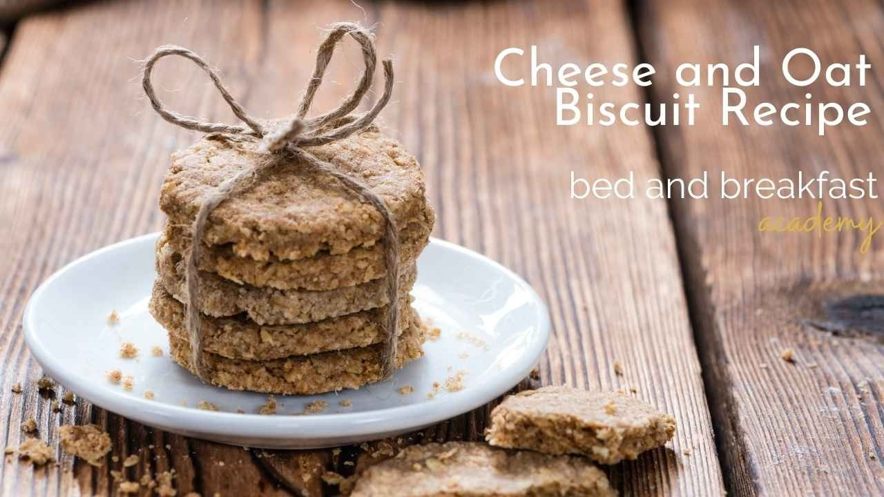 a stack of 5 oat biscuits, wrapped with a piece of string on a white saucer on a rustic wooden table
