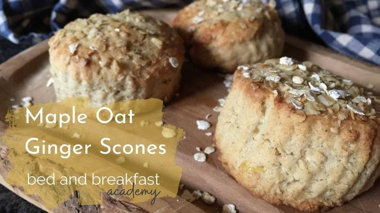 Maple oat ginger scones - 3 oat topped scones on a wooden platter