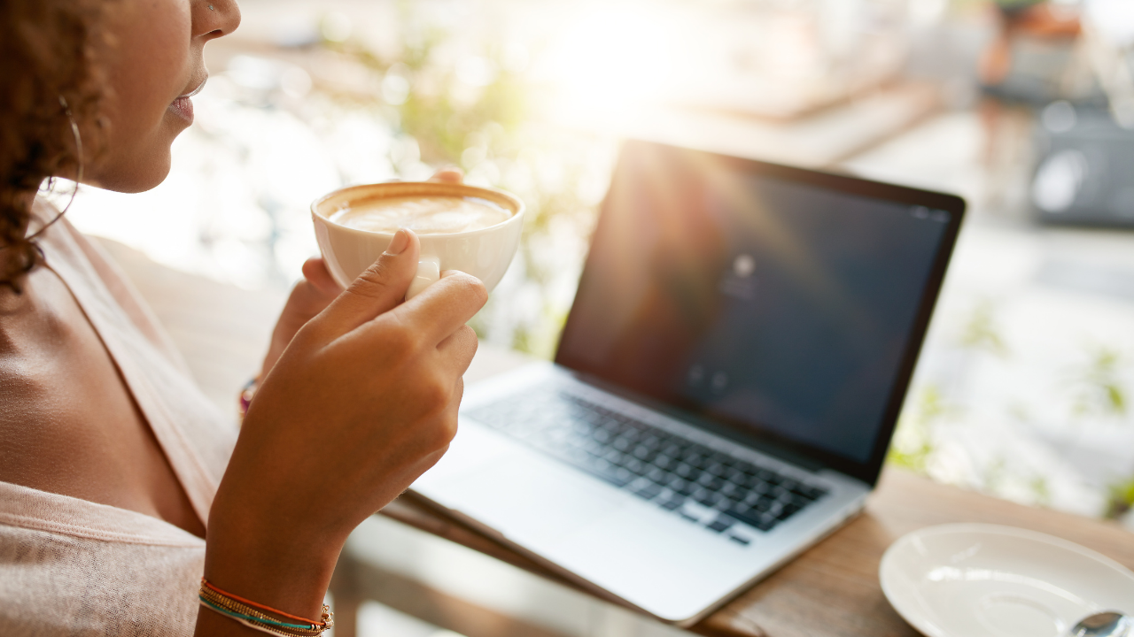 Woman in front of the computer with coffee early in the morning