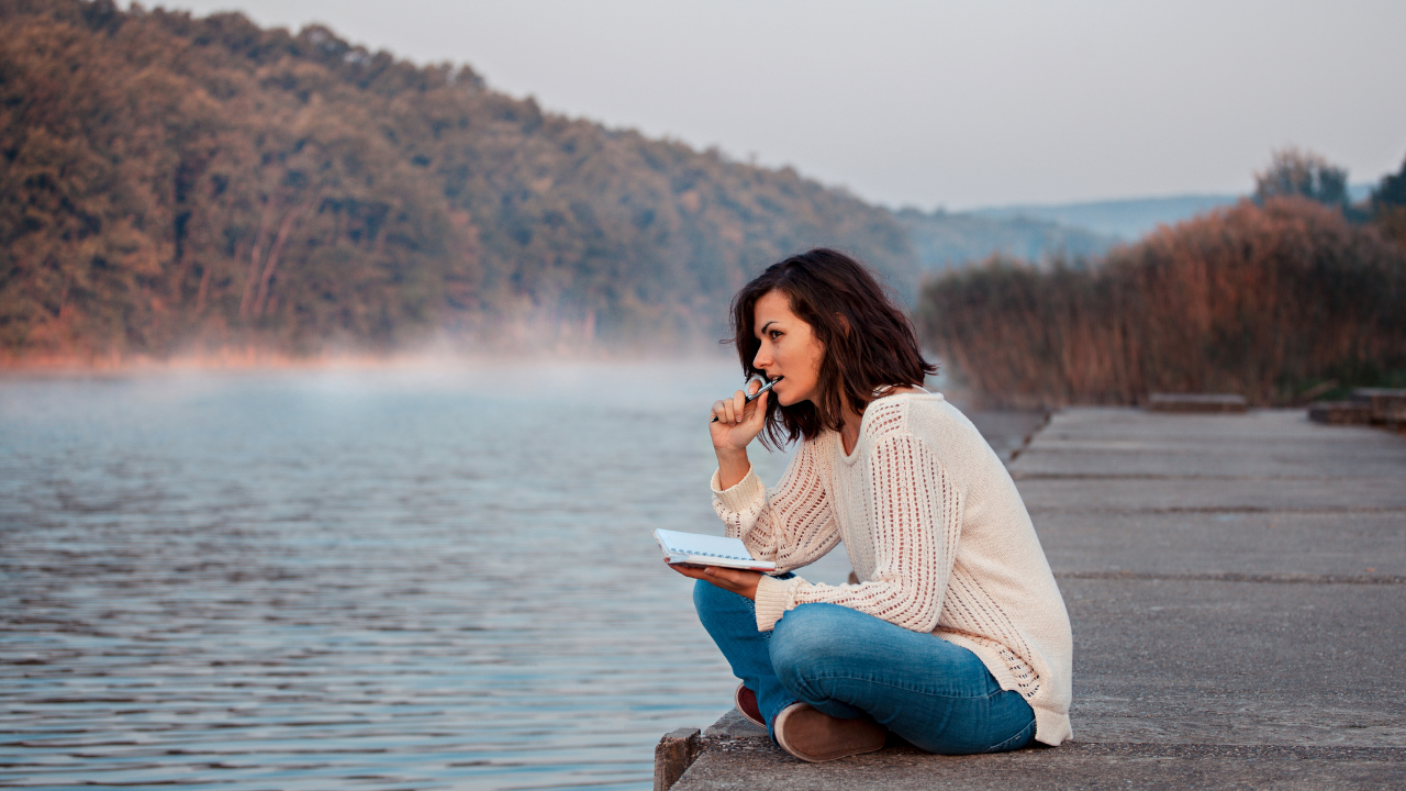 Woman pondering by the lake