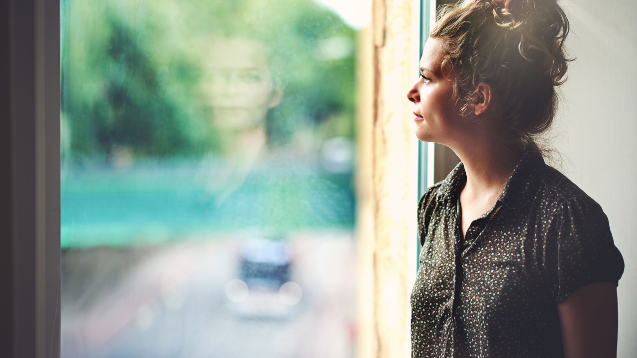 Woman Looking at Reflection of Her Self