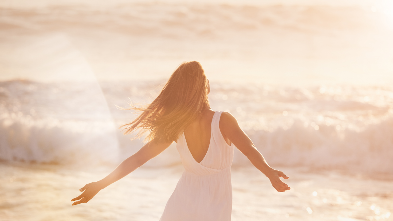Woman Expressing Freedom in the Beach, Sunset