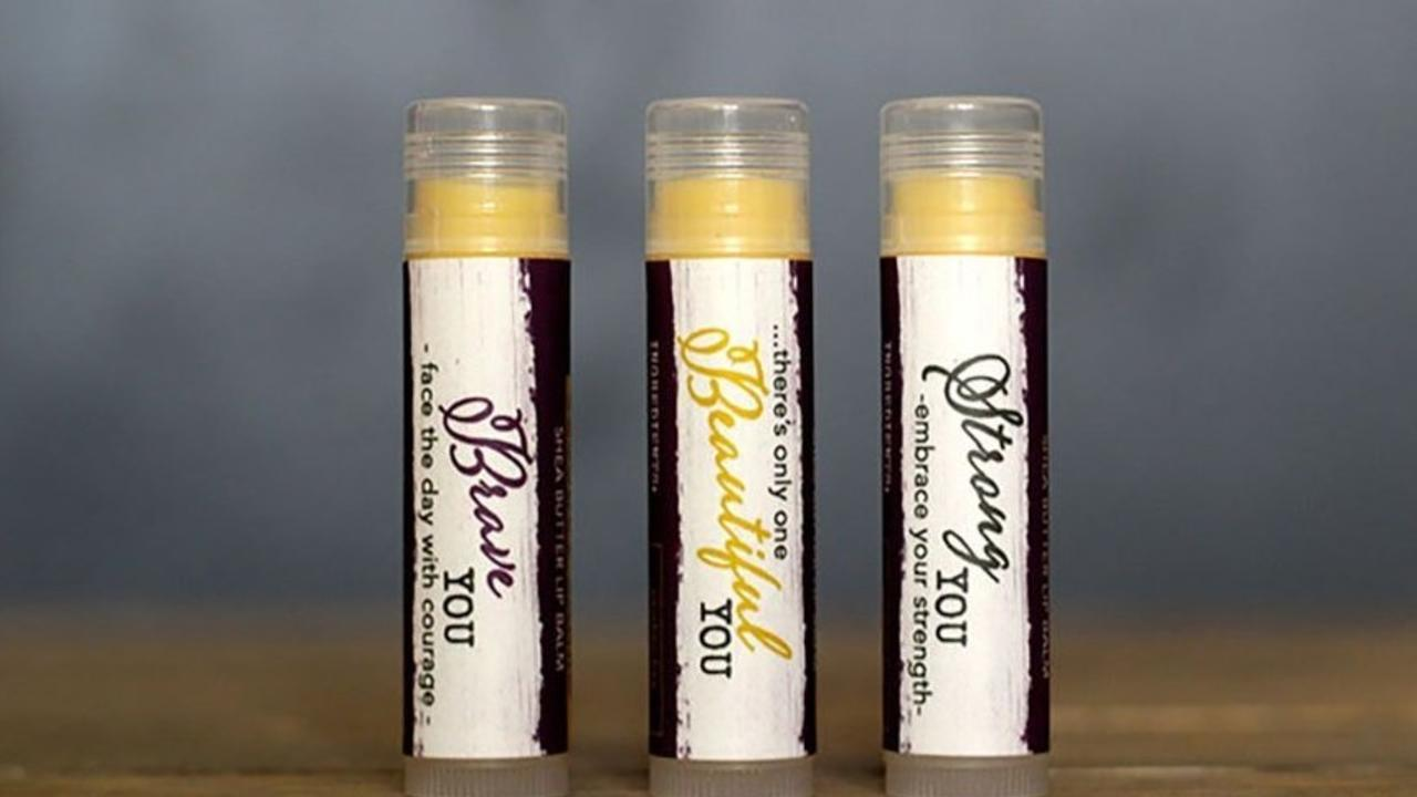 three tubes of beeswax lip balm