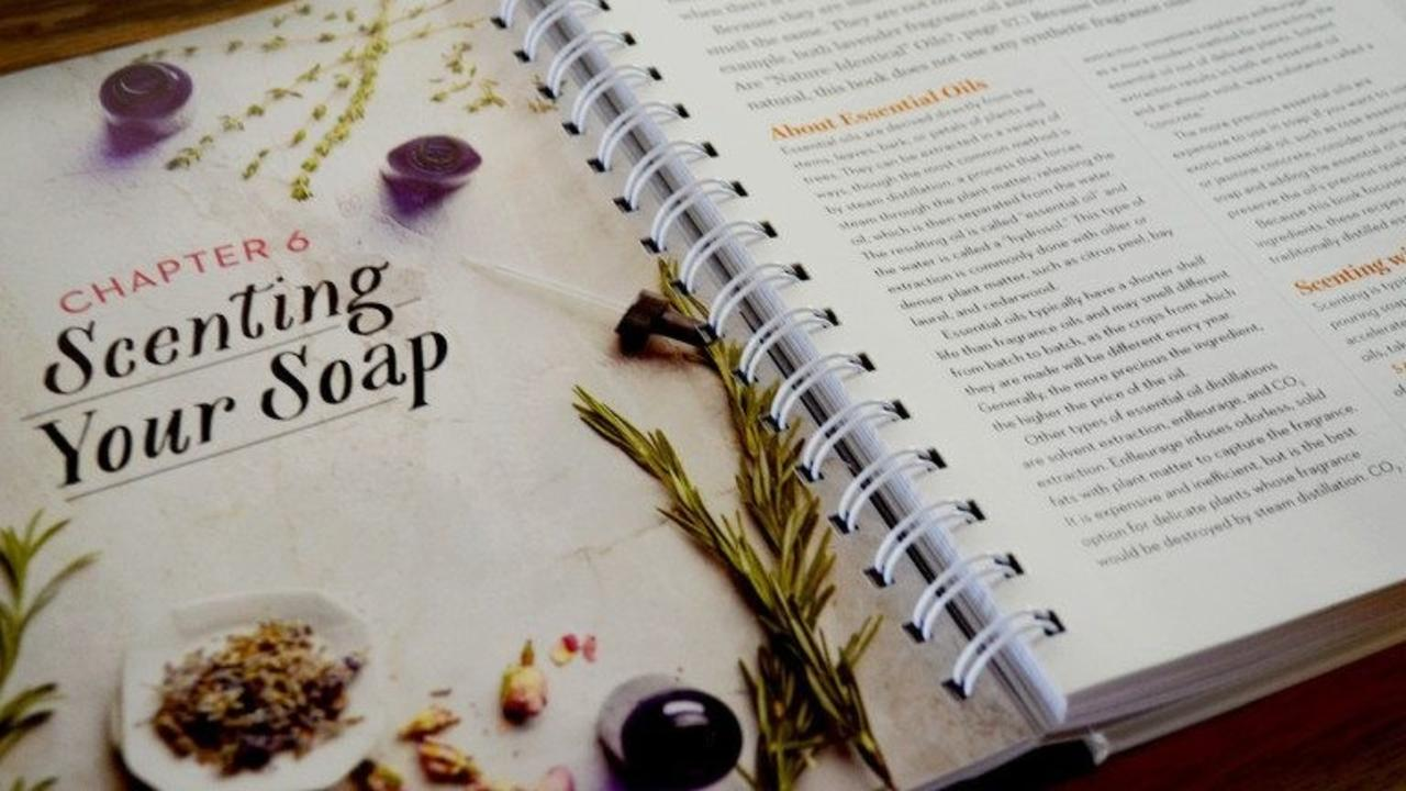book open to page about scenting your soap