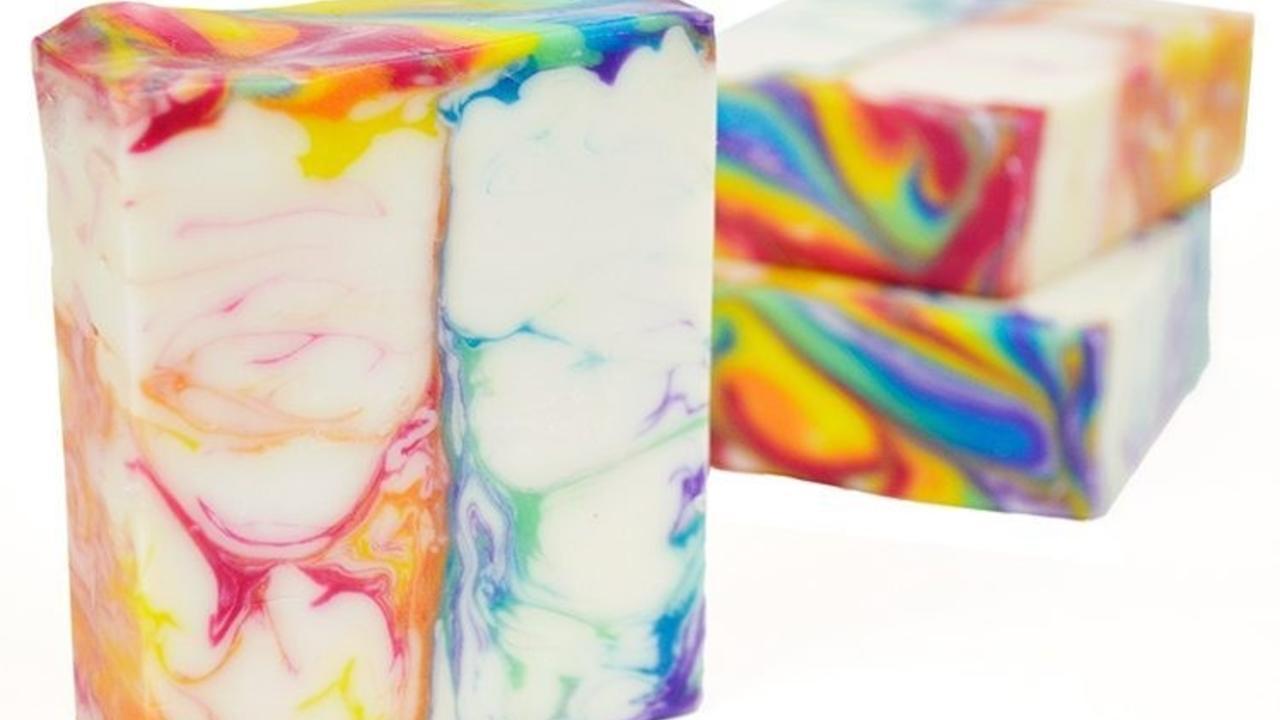 three bars of rainbow swirled soap