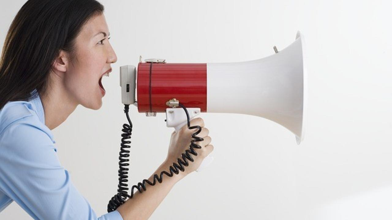woman yelling into megaphone