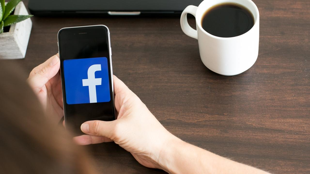 phone with the facebook logo