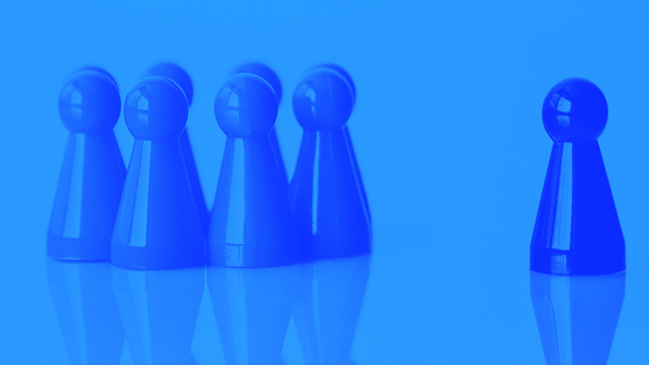 Group of Blue Figurines one Standing Out in