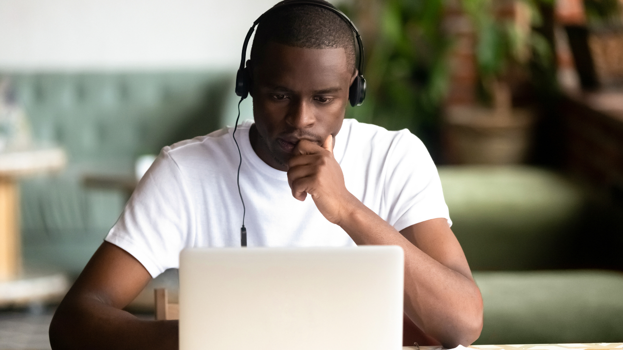 young man concentrating on computer course