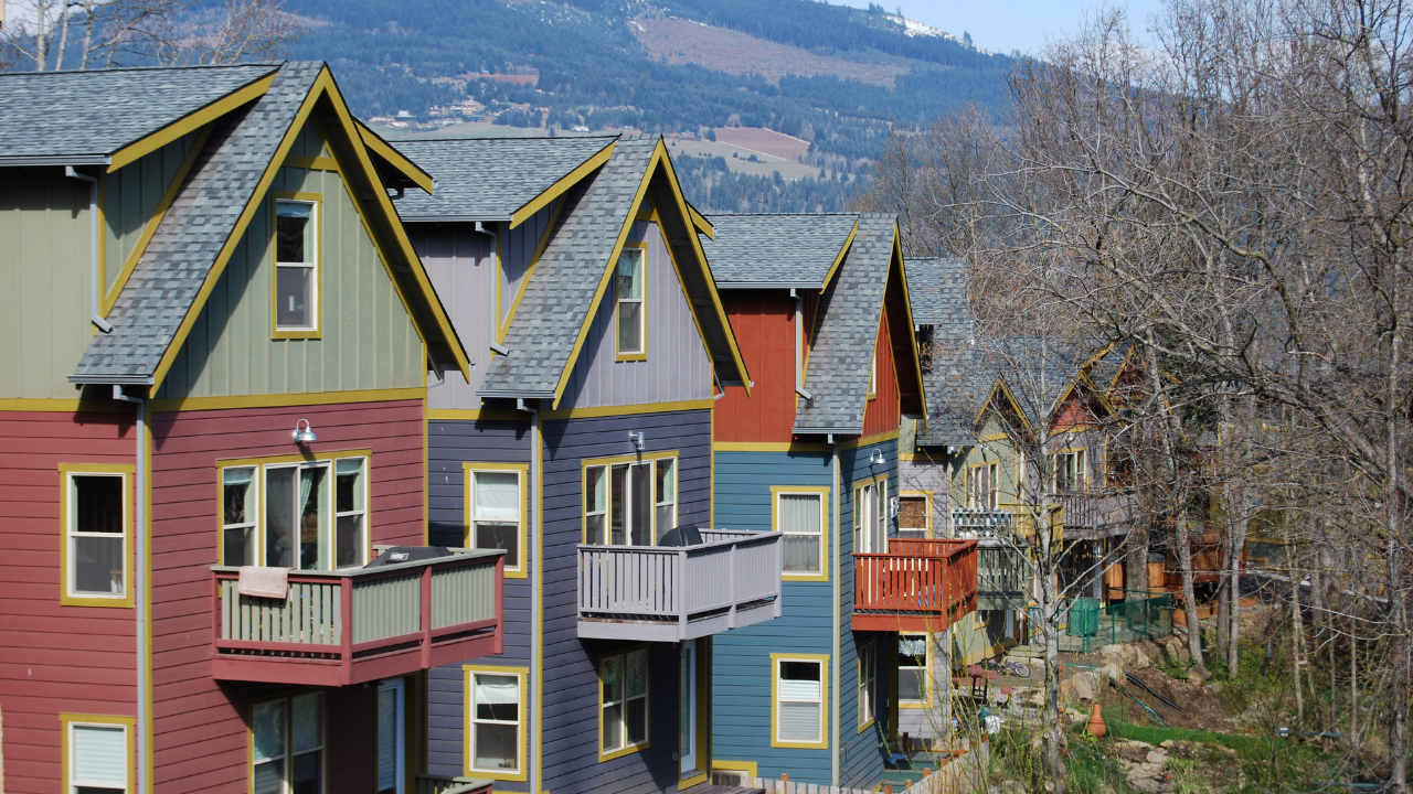 row of large similar houses on a hill