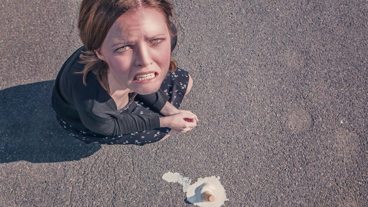 upset woman who dropped her ice cream