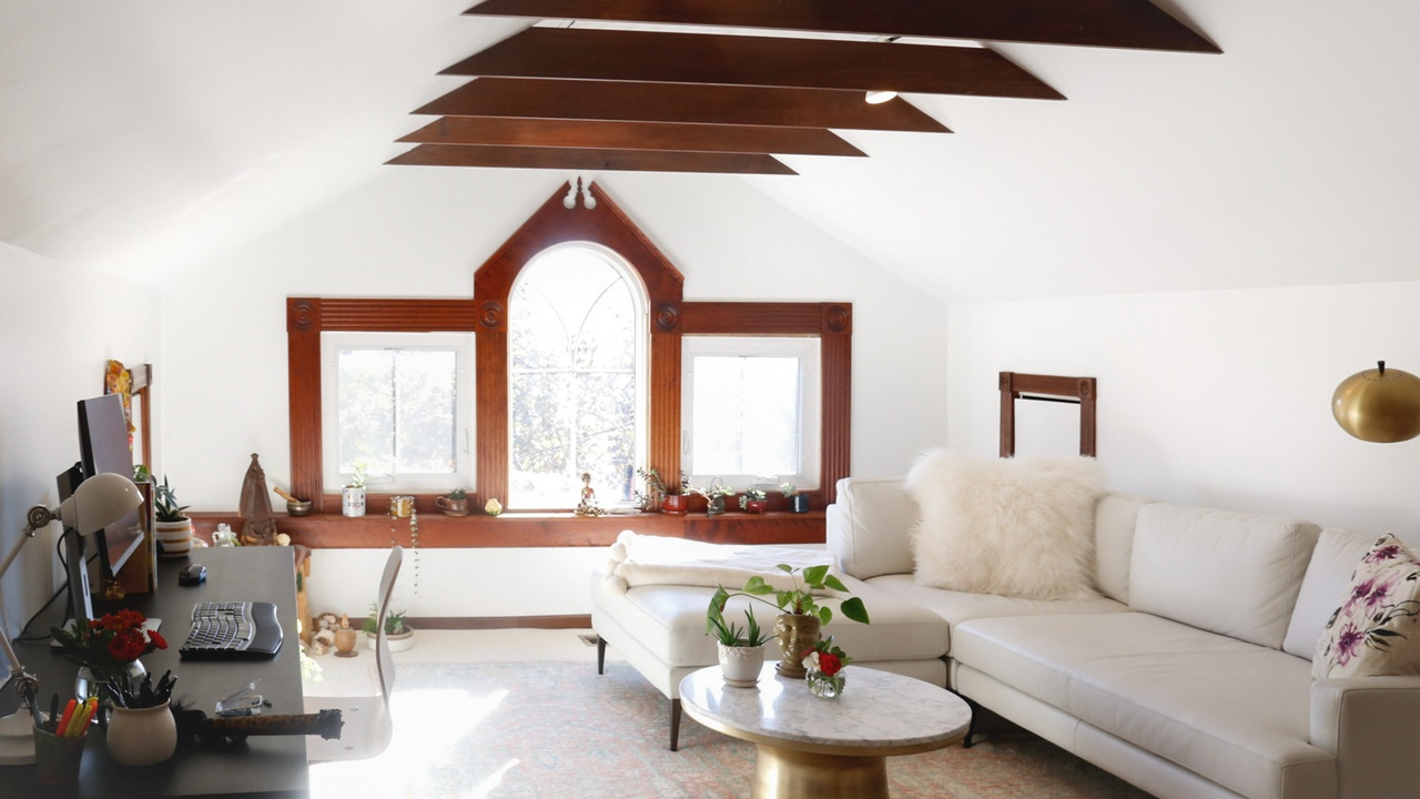 writing attic with rafters and window