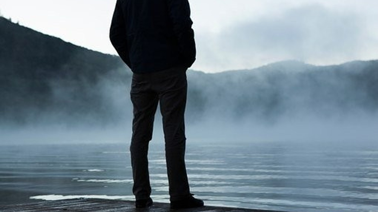 man standing by water