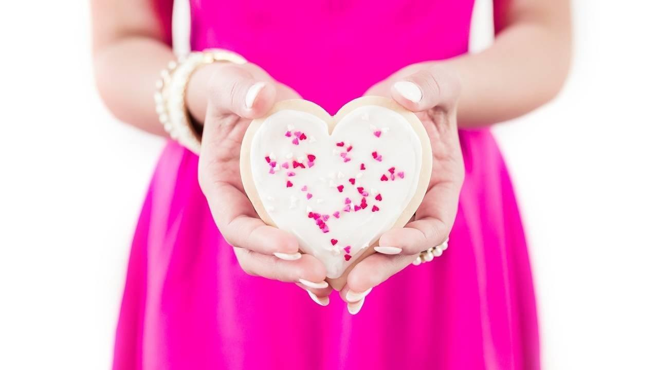 Virtual Assistant Holding Valentine Heart