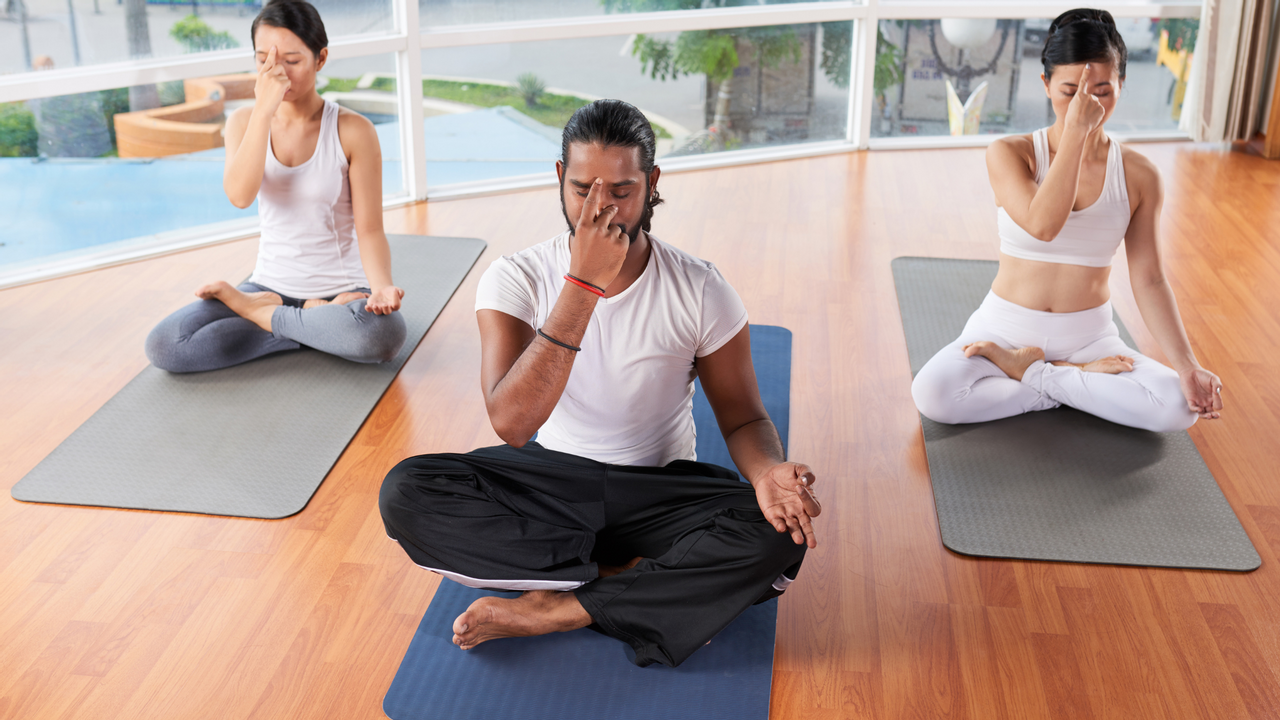 Individuals practicing breath awareness meditation