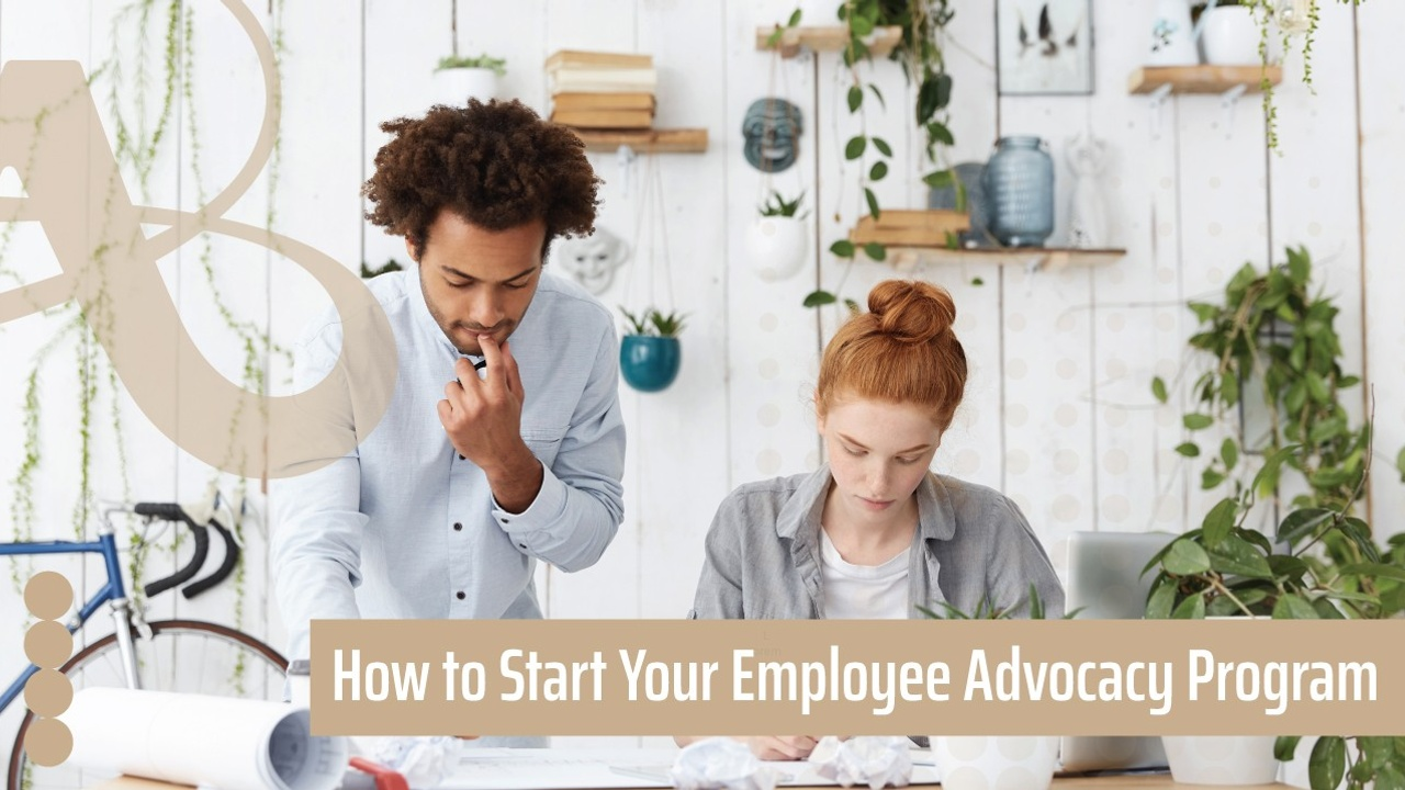 A man and woman stand looking over a desk. There are shelves and plants behind them. The text reads, how to start your employee advocacy program.