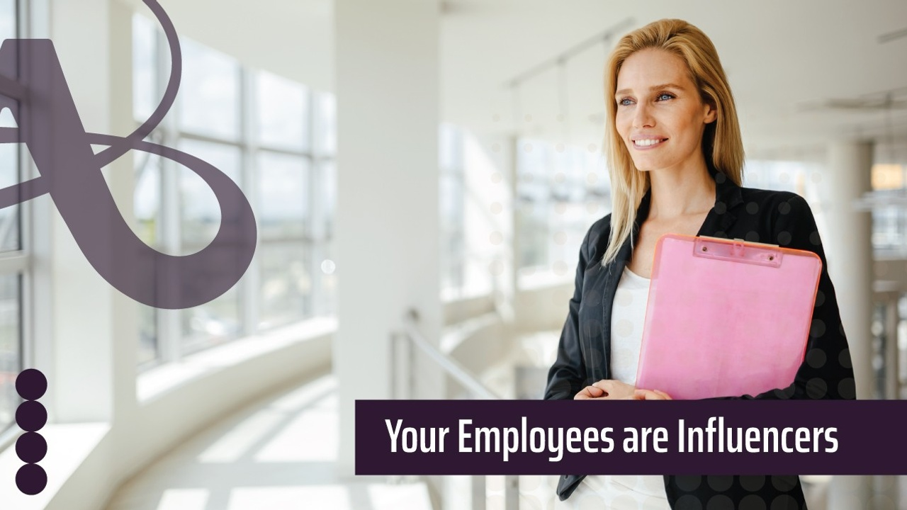 A woman holding a clipboard stands in front of aramp inside an office. The AVRO Creative logo is next to the image. The text reads, Your employees are influencers.