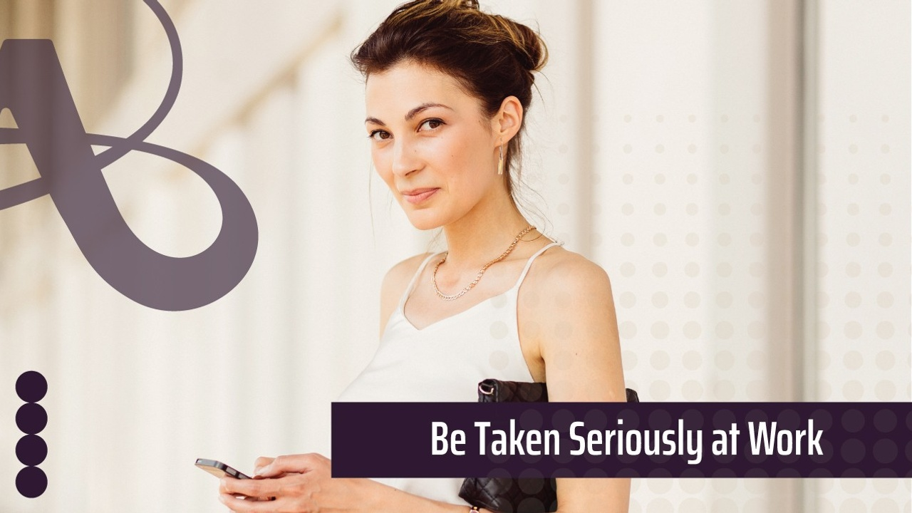 Female engineer holds an iPhone and looks at the camera. The text reads, be taken seriously at work.