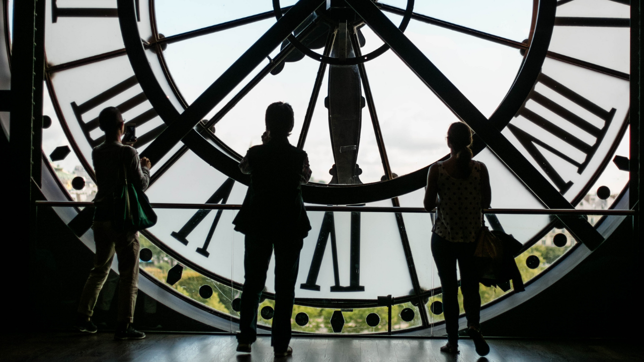 people inside a clock tower