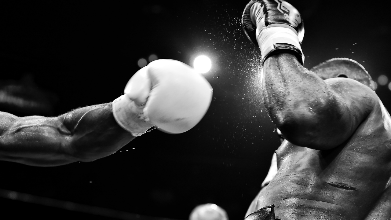 image of boxer getting hit to support blog post about starting stories in the middle
