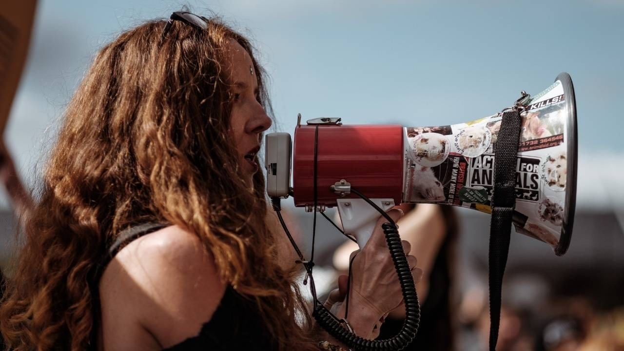 image of a woman with a megaphone to support a bog post about persuasion and influence
