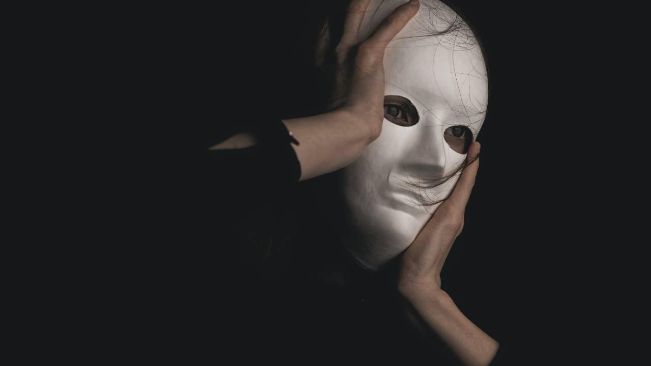 person in mask representing identity