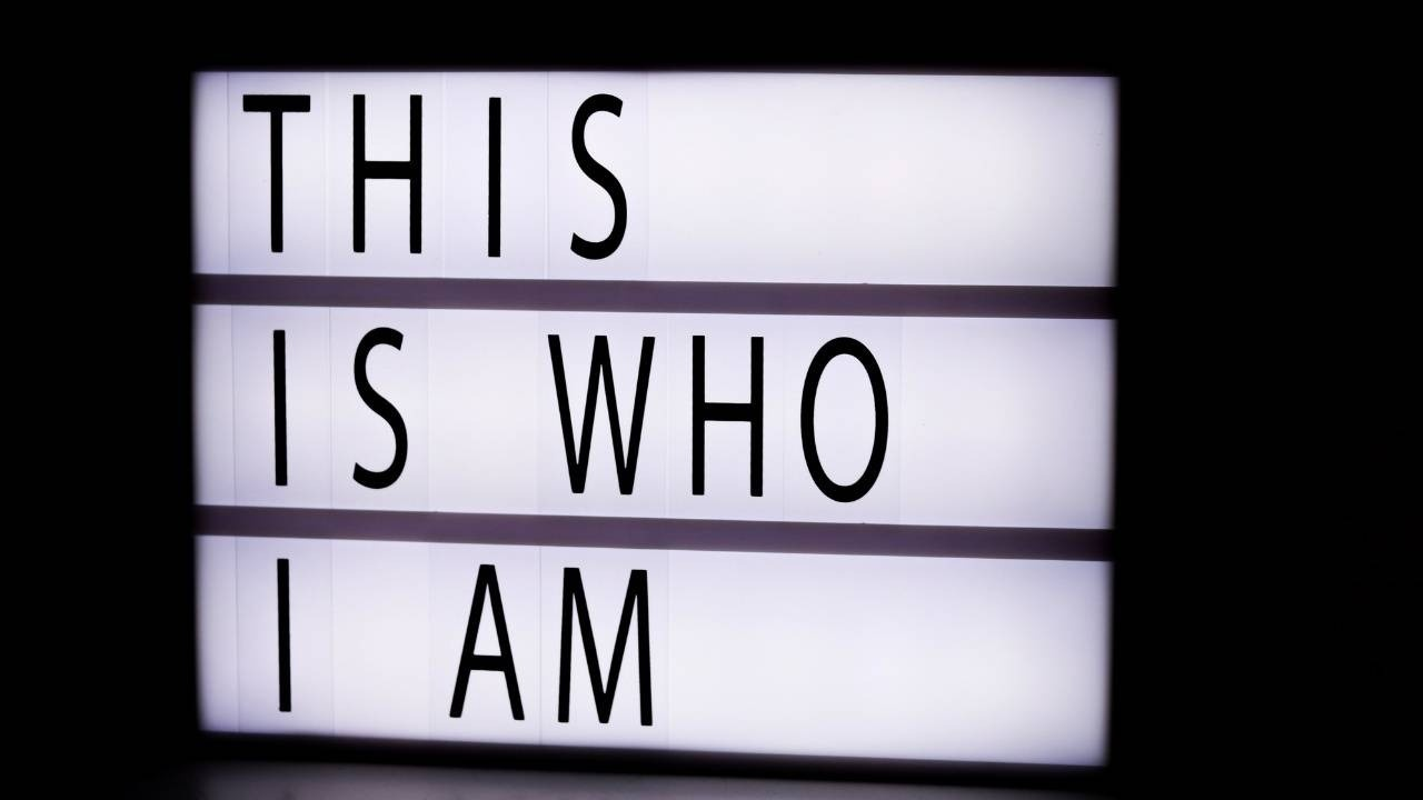 image of sign that says THIS IS WHO I AM to support blog post about routines and relationships