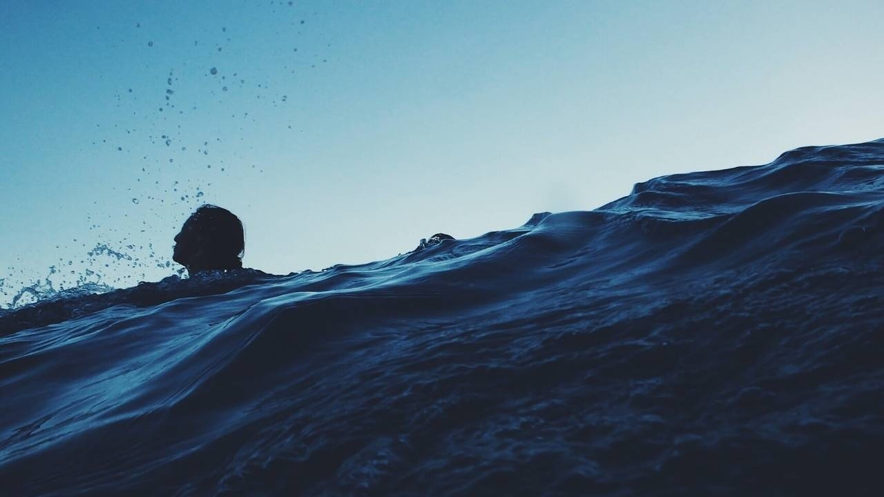 image of drowning person to support post about overwhelm