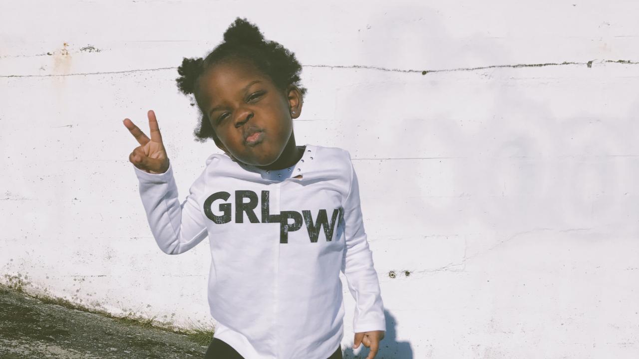 girl in grl pwr hoodie