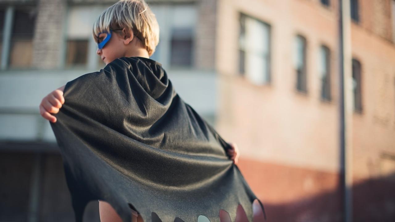 Young boy dressed like a superhero